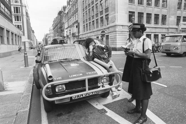 Radio DJ Dave Lee Travis has an encounter with traffic wardens as he unveils his customised 'London-proof' car. Date: 19/08/1980