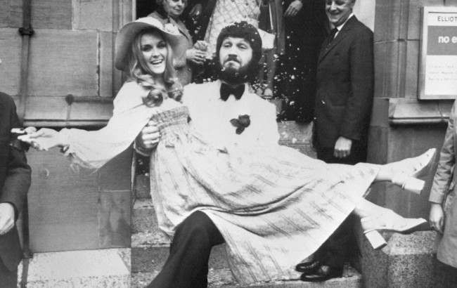 BBC DJ Dave Lee Travis carries his Swedish wife Marianne Bergqvist following their wedding at Manchester Registry Office. Date: 05/06/1971