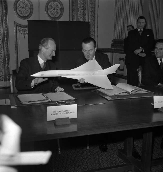 Julian Amery, the British Minister of Aviation and Geoffroy de Courcel, left, the French ambassador in London, look at a model of a proposed supersonic airliner, on November 29, 1962 in Lancaster House, London, United Kingdom, where they signed an Anglo-French agreement for the development jointly of a supersonic passenger airplane. Each country has agreed to spend between £75 million and £85 million for development and the tooling of production lines.