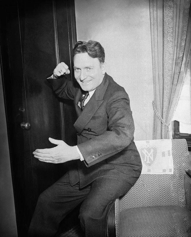 "The Reverend Gerald L.K. Smith, who quit his Shreveport, La., parish to become national organizer of the ""Share The Wealth"" movement, gestures dramatically while explaining the theory of the ""every man a king"" platform, March 18, 1935 in New York City. He predicted he will enroll 15,000,000 under his banner by Christmas."