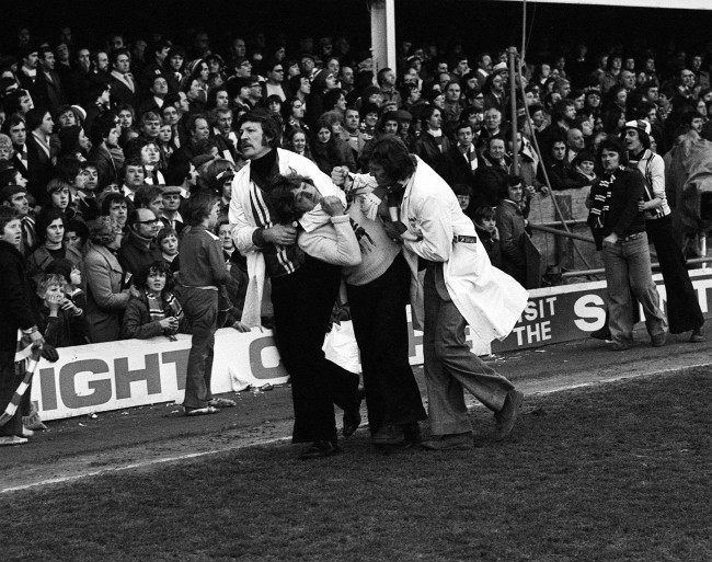 Southampton stewards 'handling' a fan after fights broke out between rival supporters at the end of the FA Cup tie betwen Southampton and Manchester United at The Dell, Southampton. Date: 27/02/1977