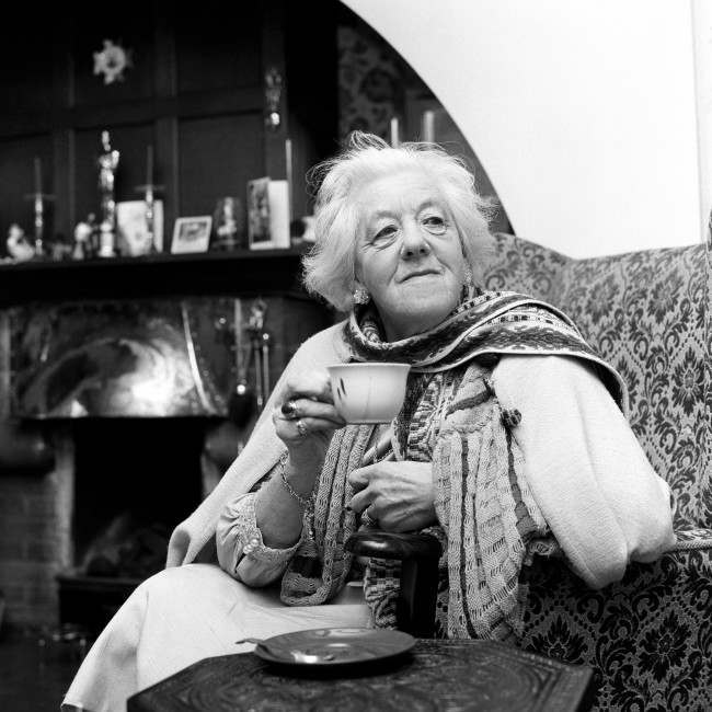 Margaret Rutherford who becomes a DBE (Dame Commander of the Order of the British Empire) in the New Year Honours, celebrates with a cup of tea at her home in Buckinghamshire. Date: 01/01/1967