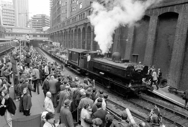Railway enthusiasts gather on the platforms at Barbican Station to bid farewell to the last steam train on London Transport railways. A commemorative journey was run from Moorgate to Neasden depot.