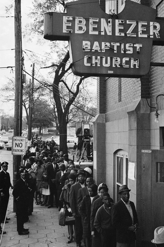 Mourners waiting to view the body of Dr. Martin Luther King Jr. line up outside the Ebenezer Baptist Church in Atlanta just after dawn April 9, 1968. Many had dept a night-long vigil.