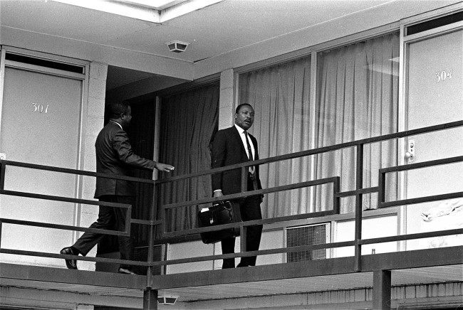 This April 3, 1968 file photo shows Rev. Martin Luther King, Jr. walking across the balcony of the Lorraine Motel in Memphis. The civil rights leader was standing on the balcony of the Lorraine Motel when he was killed by a rifle bullet on April 4, 1968. James Earl Ray pleaded guilty to the killing and was sentenced to 99 years in prison. He died in prison in 1998.