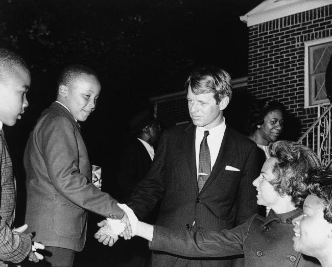 Ethel Kennedy shakes hands with Martin Luther King III after she and her husband Robert F. Kennedy, center, visited his mother Coretta Scott King at her Atlanta home, April 8, 1968.