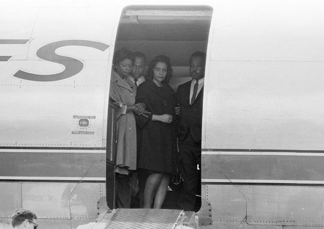 Coretta Scott King, center, widow of slain civil rights leader Dr. Martin Luther King, Jr., is comforted in the doorway of an airliner in Memphis, Tenn., April 5, 1968, as her husband's body is brought up the ramp.