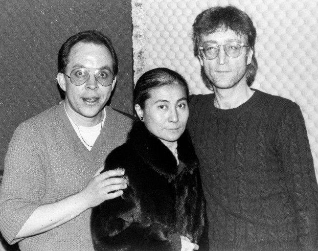 BBC Radio One disc jockey Andy Peebles (Left) with ex-Beatles star John Lennon and his wife, Yoko Ono, in New York at the weekend when he was interviewing the couple for a radio series to be broadcast next year. The pop superstar was shot dead by Mark Chapman last night as he and his wife arrived at their New York apartment. Date: 09/12/1980
