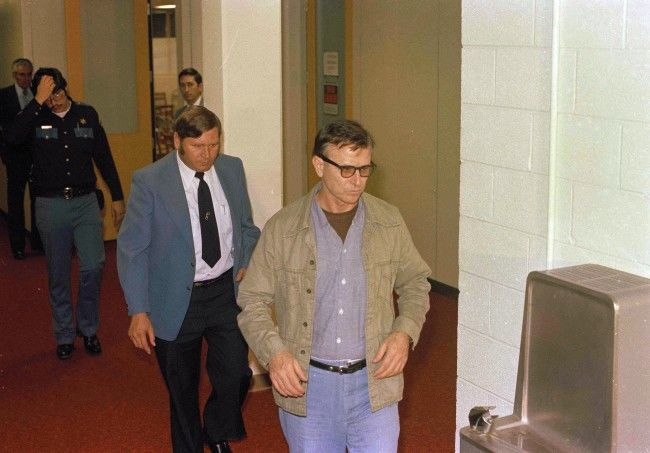 James Earl Ray, wearing jacket and tie, is shown at his escape trial in Tennessee, Nov. 1977.