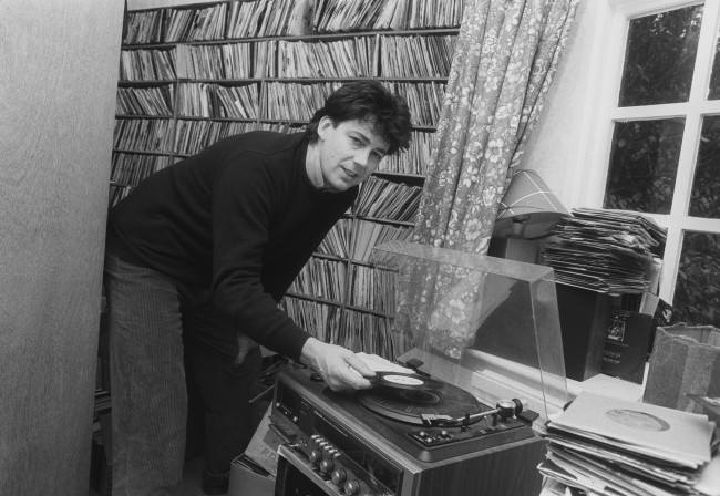 """Radio One DJ Mike Read, 36, plays one of his favourite records at his Victorian-Gothic seven-bedroom Surrey mansion near Dorking. Read, who has spent three years setting 20 poems by the late Poet Laureate Sir John Betjeman to music, hopes to stage a musical entitled """"Teddy Bear to the Nation"""" with the backing of composer Andrew Lloyd Webber in London's West End this summer. Date: 12/03/1987"""