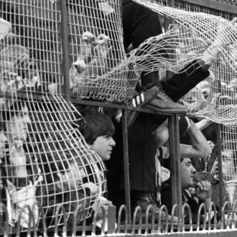 1978: Caged Spurs Fans Peer Through The Bent Steel Mesh At Southampton