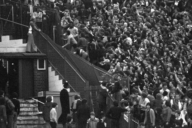 Rioting Tottenham Hotspur fans tear down a section of iron railings in a bid to reach the Chelsea supporters before a Division One game at London's Stamford Bridge ground. archive-pa186658-1   Date: 18/11/1978