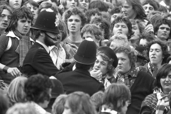 Soccer - League Division One - Queens Park Rangers v Liverpool - Loftus Road Police break up a scuffle in a crowded Loftus Road in London, where QPR were playing Liverpool. archive-pa172429-3