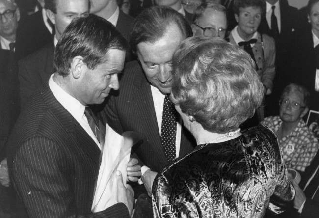 Prime Minister Margaret Thatcher talks to former Conservative Party deputy chairman Jeffrey Archer (left) and broadcaster David Frost, at the opening of Gemma Levine's photography exhibition at the Barbican Centre in London. Date: 09/11/1987