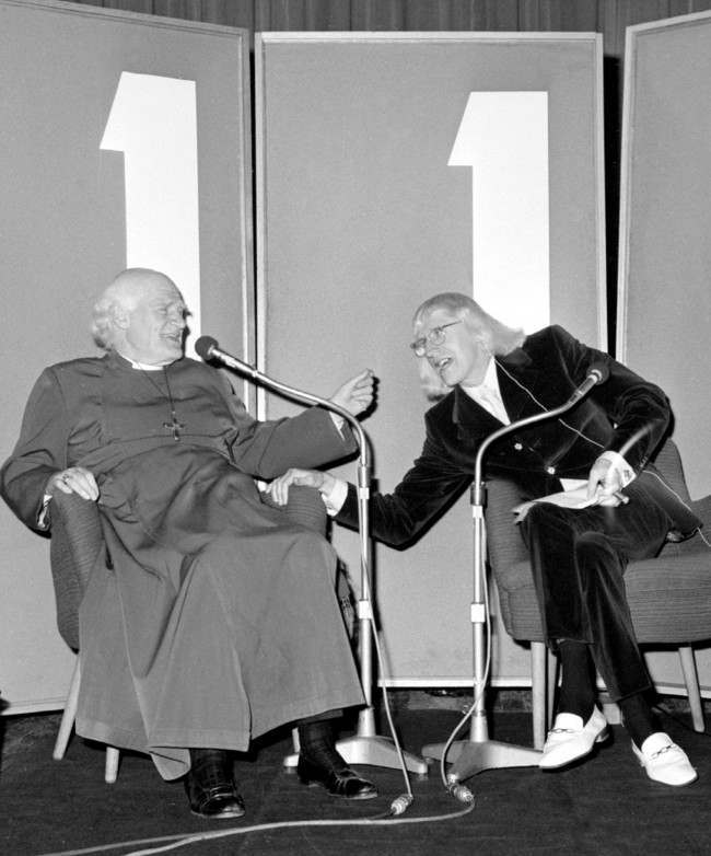 "Jimmy Savile (r), host of BBC Radio One's programme ""Speak Easy"", looks like a bit of a laugh in. Saville's guest is Dr Michael Ramsey, Archbishop of Cantebury, shown during the recording of the programme at the BBC's Paris Theatre, Lower Regent Street, London. Date: 30/04/1971"