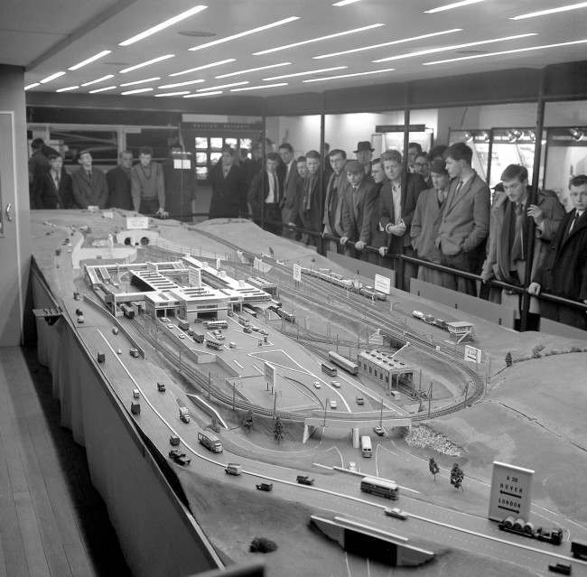 Drawing crowds at the British Railways (London Midland Region) railway exhibition taking place in Manchester is this 30ft long working model of the railway terminal at the British end of the proposed Channel Tunnel. The model includes the main terminal buildings containing a passenger station, car and lorry-loading platforms and a working railway layout with an Anglo-Continental freight marshalling yard.