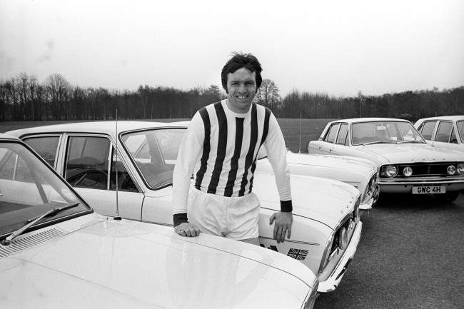 England and West Bromwich Albion's Jeff Astle, wearing his West Bromwich Albion shirt, sits on the bonnet of his new Ford Cortina