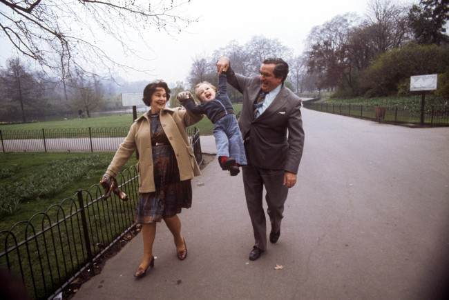 Chancellor of the Exchequer Denis Healey, taking time out from his preparations for next week's Budget, is joined by his wife Edna and their 18-month-old grandson Thomas Copsey for a stroll in St James's Park, London.