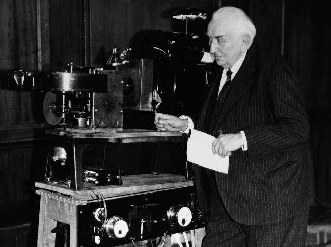 Louis Lumiere who made his first film in February 25, 1935 shows a new invention of his by which he projected a stereoscopic image on the screen, March 6, 1935. Location unknown.