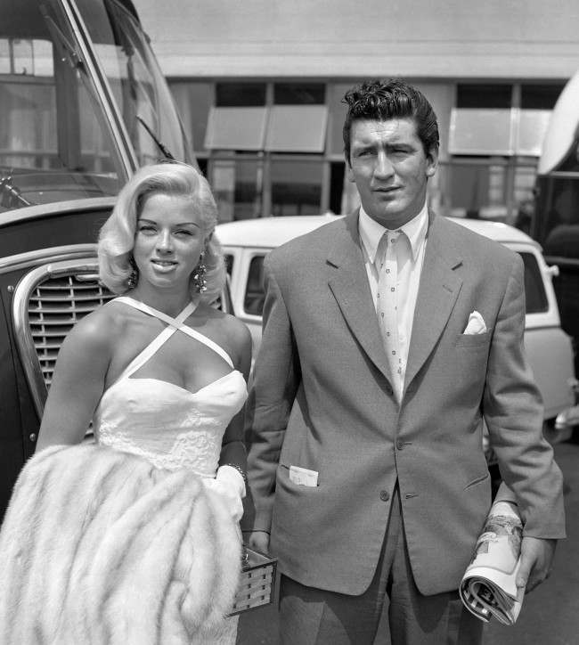 Film star Diana Dors, who has filed a divorce petition against her husband, Dennis Hamilton, pictured with actor Tommy Yeardye before they left London Airport for Rome. Ref #: PA.1945649  Date: 02/07/1957