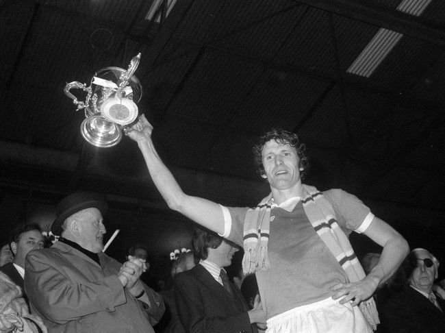 Manchester City captain Mike Doyle shows the League Cup after beating Newcastle United 2-1 at Wembley.
