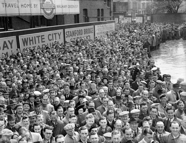 The start of the Football season. League football started for the first time in seven years, and it attracted large crowds. Here spectators are gathered outside Chelsea's Stamford Bridge ground where Bolton Wanderers are the visitors in the First Division.  Ref #: PA.1991435