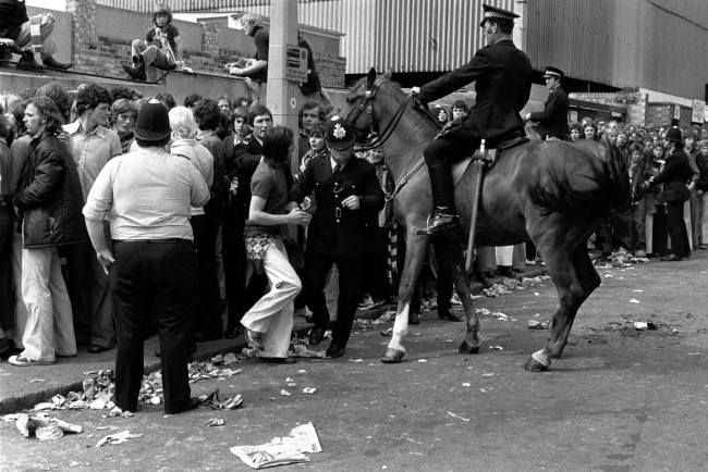 A mounted policeman watches the situation closely as colleagues deal with crowd trouble at the Brisbane Road ground before the League Division Two match between Orient and Manchester United on the opening day of the 1974/75 season.