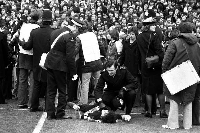 First aid for a young fan at White Hart Lane after crowd trouble broke out during the League Division One match between Tottenham Hotspur and Manchester United. Date: 12/02/1977