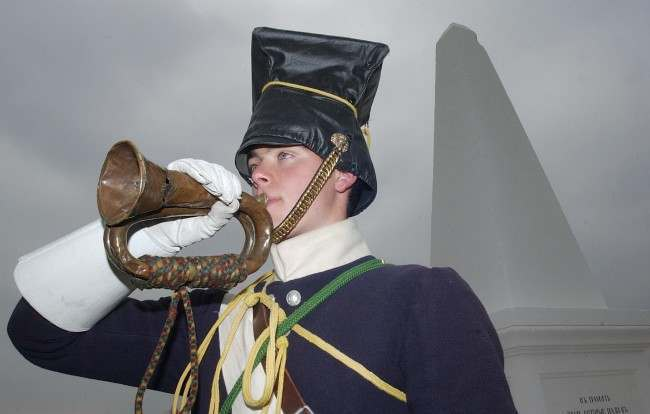John Hathaway-White 18 year old student from Sutton Coldfield who is studying Music and Russian at Birmingham University, plays the original bugle that was played by Billy Britain to sound The Charge of The Light Brigade, at a memorial service at a British monument for those who lost their lives in The Battle of Balaclava, on the 150th anniversary of The Charge of The Light Brigade, Crimea, Ukraine.