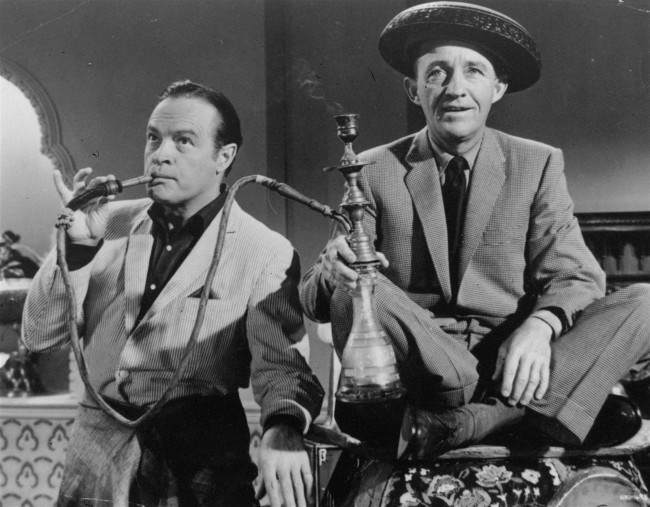 "Bob Hope and Bing Crosby enjoy a smoke from a water pipe on March 30, 1962 photo in a scene from the 1962 film ""The Road to Hong Kong"""