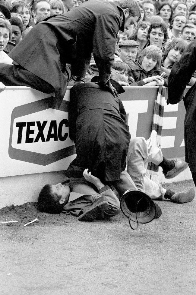 PA. 2936419 Soccer - Football League Division One - Tottenham Hotspur v Chelsea - White Hart Lane An unruly fan is pinned down by a policeman after trouble erupted before the match Date: 19/04/1975