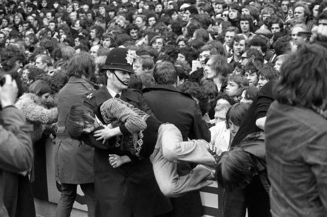 Soccer - Football League Division One - Tottenham Hotspur v Chelsea - White Hart Lane A young fan is carried away by a policeman after trouble erupted before the match Date: 19/04/1975