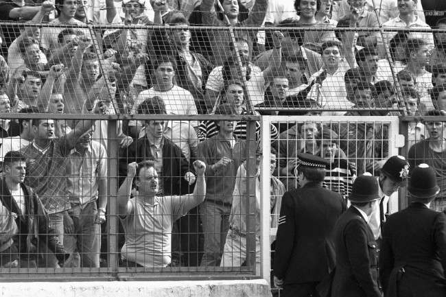 Soccer - Barclay's League Division One - Promotion/Relegation Play Offs - Final Second Leg - Chelsea v Middlesbrough - Stamford Bridge Chelsea fans hurl abuse at police officers after seeing their side relegated to Division Two Ref #: PA.2939705  Date: 28/05/1988