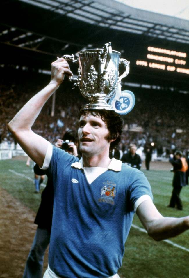 Manchester City's Mike Doyle celebrates with the League Cup
