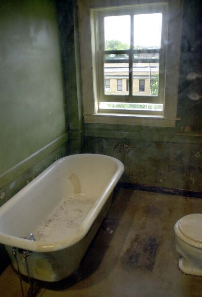 * The new $11 million expansion of the National Civil Rights Museum in Memphis, Tenn., includes the communal bathroom, seen here in this Sept. 24, 2002 file photo, where confessed assassin James Earl Ray shot Dr. Martin Luther King Jr., on April 4, 1968. Ray admitted shooting King from the small bathroom window across from the Loraine Motel in Memphis, Tenn. The bathroom is now encased in glass. The flophouse bathtub has been sold to an online casino for $7,600, the tub's owner said Thursday.