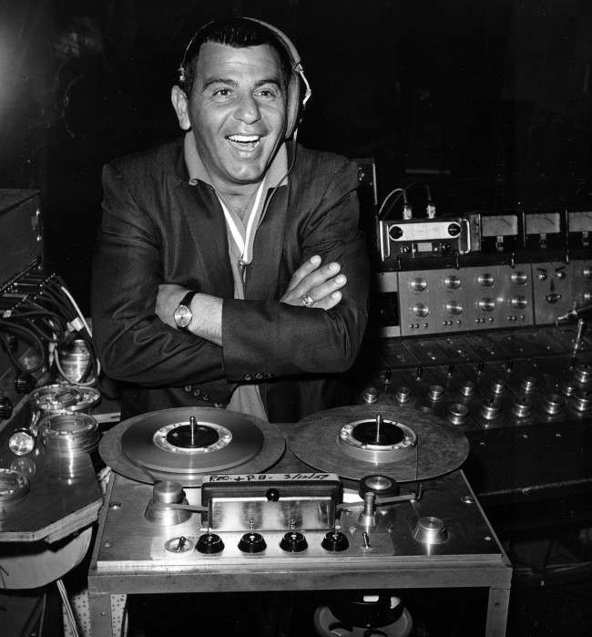"Ross Bagdasarian, an actor, songwrither and creator of Alvin and The Chipmunks, also known as his ""chipmunk"" alter ego David Seville, listens to the playback from a tape recorder at Liberty Records in this March 30, 1959 file photo taken in Los Angeles. Almost 50 years later, the Chipmunks, Alvin and his brothers Simon and Theodore, are still singing, voiced now by Bagdasarian's son and his son's wife, Janice Karman."