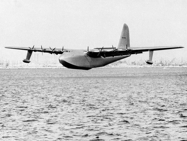 "Howard Hughes' ""Spruce Goose"" glides over the water in this Nov. 2, 1947, file photo in Long Beach, Calif. In 1947, Hughes flew the Spruce Goose to prove a point to Sen. Owen Brewster, R-Maine, who led the Senate War Investigating Committee."