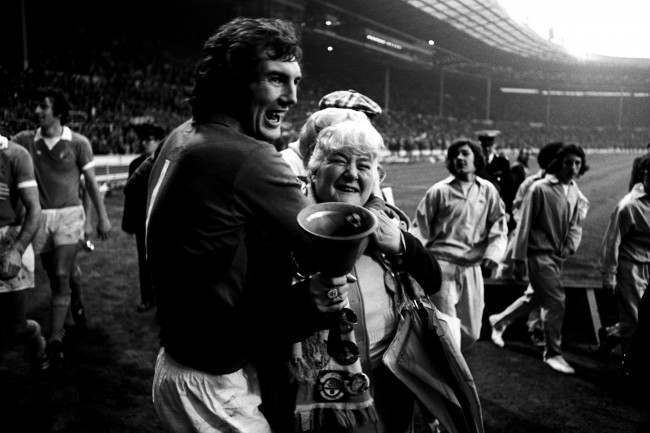 Manchester City goalkeeper Joe Corrigan (l) celebrates victory with famous fan Helen 'The Bell' Turner (r)