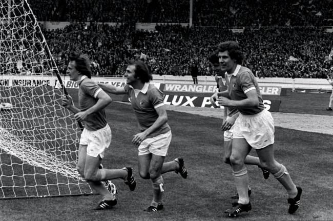 (L-R) Manchester City's Peter Barnes celebrates his goal with teammates Dennis Tueart and Joe Royle