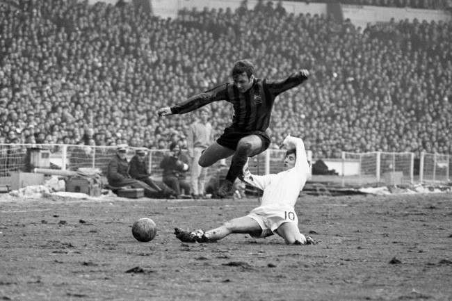 West Bromwich Albion's Asa Hartford (r) slide tackles Manchester City's Glyn Pardoe (l)