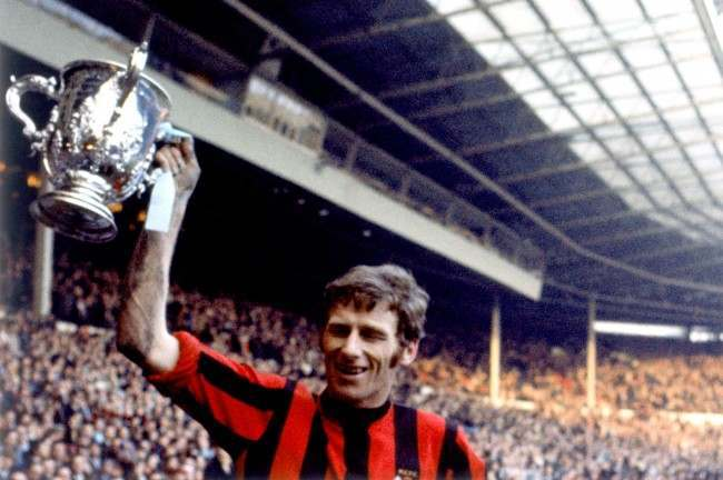 Manchester City captain Tony Book celebrates with the League Cup after his team's 2-1 victory