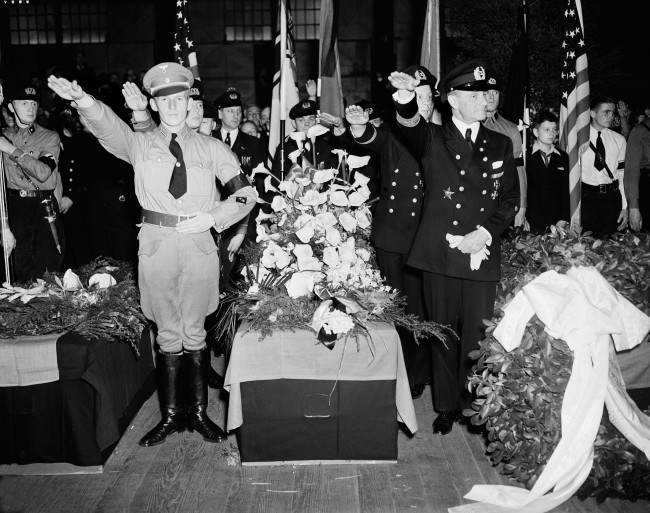 German Nazis give the salute as they stand beside the casket of Capt. Ernest A. Lehmann, former commander of the zeppelin Hindenburg, during funeral services held on the Hamburg-American pier in New York City.