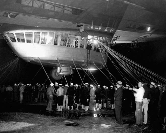 Spectators and ground crew surround the gondola of the German zeppelin Hindenburg as the lighter-than-air ship prepared to depart the U.S. Naval Station at Lakehurst, NJ,on its return trip to Germany. May 11th, 1935,