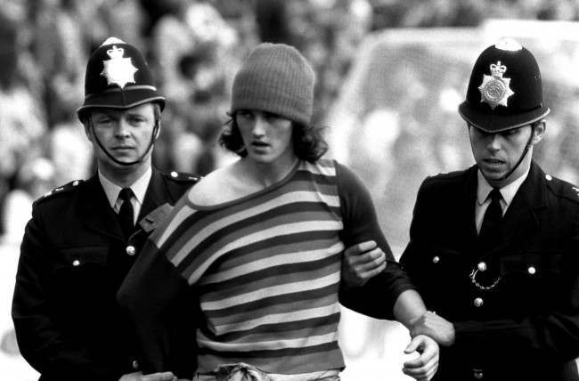 Soccer - Football League Division Two - Orient v Manchester United A Manchester United fan is arrested by two policemen NULL Ref #: PA.398282 Date: 17/08/1974