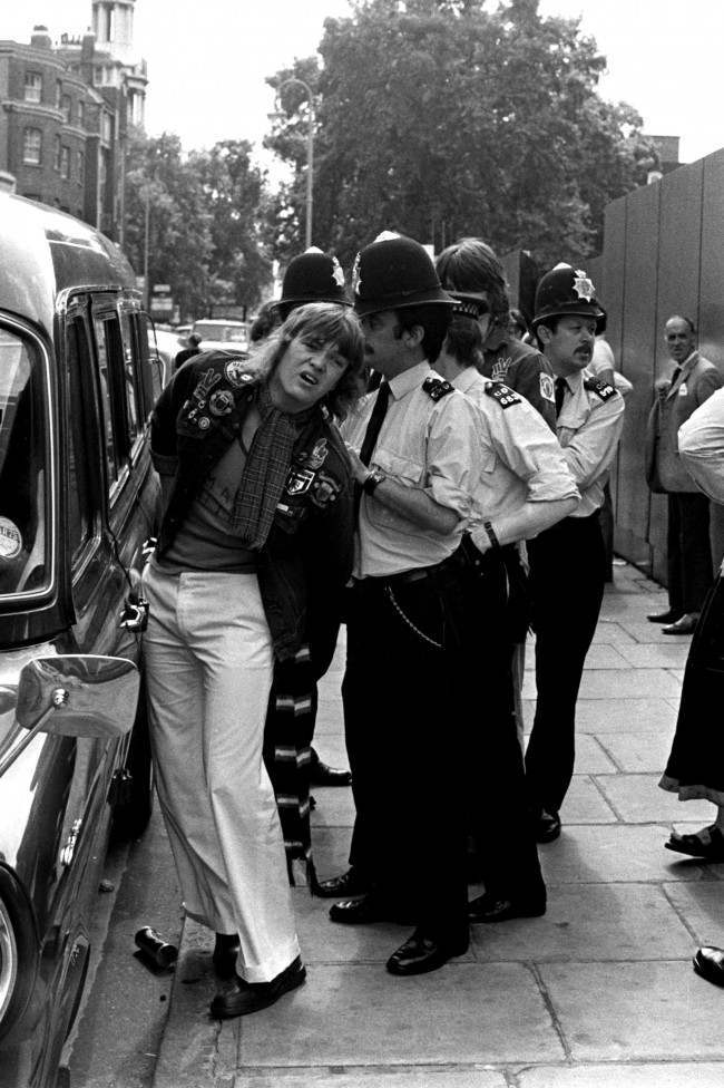 PA. 398283 Soccer - Football League Division Two - Orient v Manchester United A Manchester United fan is arrested by policeman after the riot  NULL Ref #: PA.398283  Date: 17/08/1974