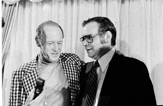 Watergate burglar E. Howard Hunt, left, embraces Cuban exile Manuel Artime, a leader of the 1963 Bay of Pigs invasion of Cuba, after a news conference in Miami, March 3, 1977.
