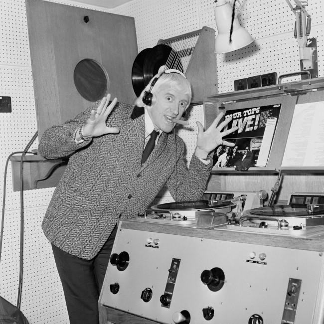 Radio One DJ Jimmy Savile, in his studio. Date: 13/01/1972