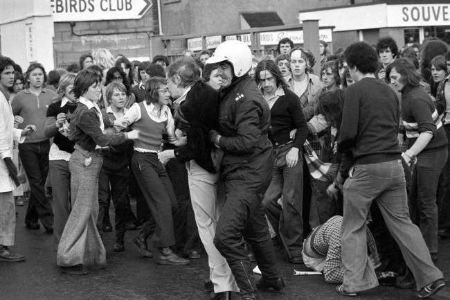 PA. 4344227 Soccer - Football League Division Two - Cardiff City v Manchester United - Ninian Park A fan is arrested during scuffles between rival fans outside Ninian Park Ref #: PA.4344227 Date: 31/08/1974