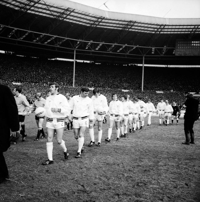 West Bromwich Albion captain Doug Fraser (l) leads his team out at Wembley