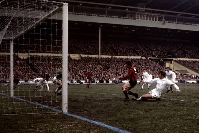 West Bromwich Albion's John Talbut robs Manchester City's Mike Summerbee as he is about to shoot.